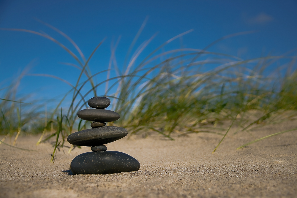 rocks balancing on top of each other on beach