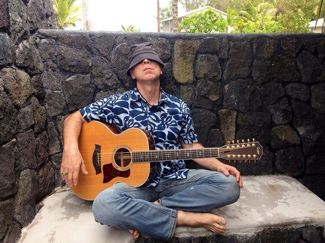 Kai sleeping with guitar