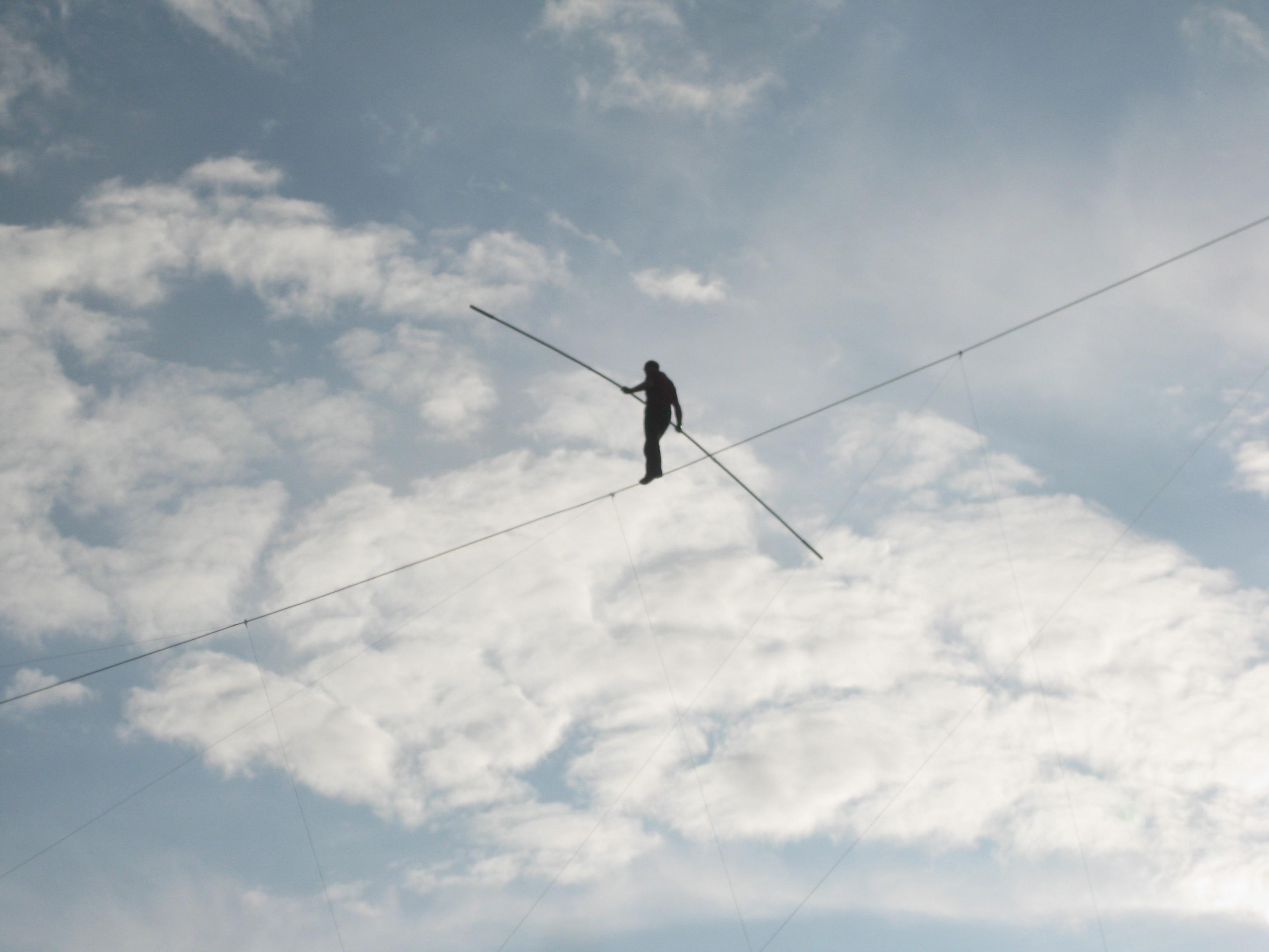 Man balancing over clouds