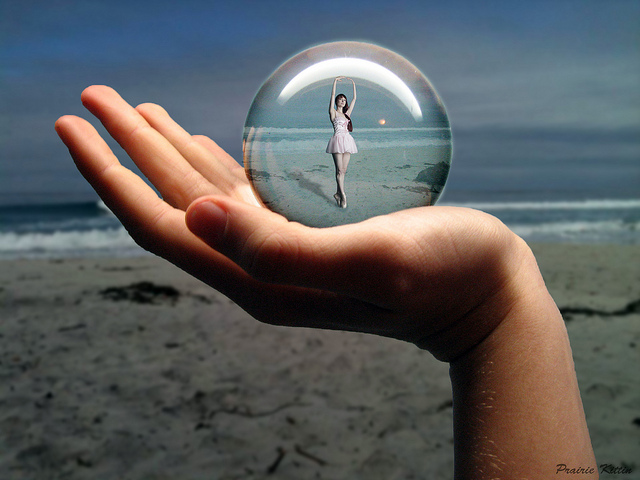 Dancer inside bubble on someone's hand