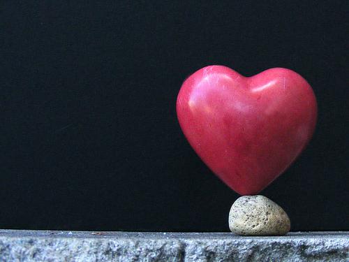 heart shaped rock balancing on rock