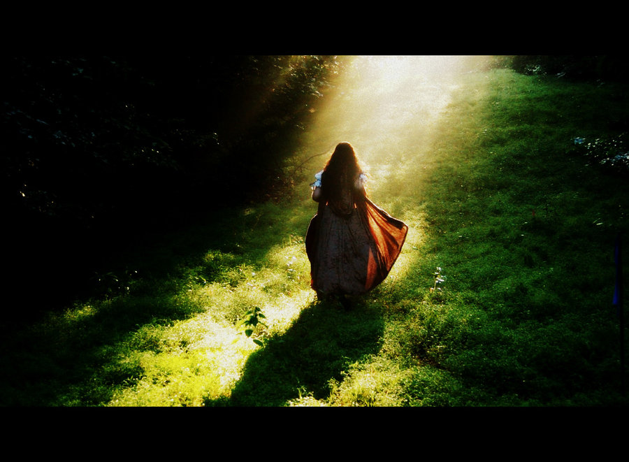 woman walking into light