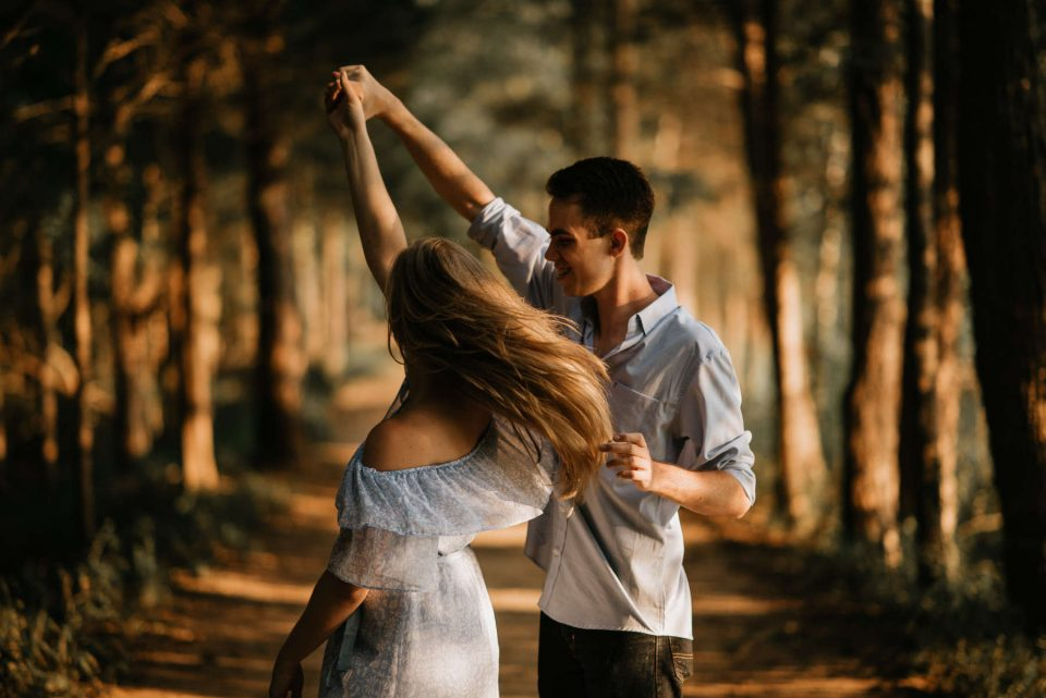 photo of couple dancing in the woods